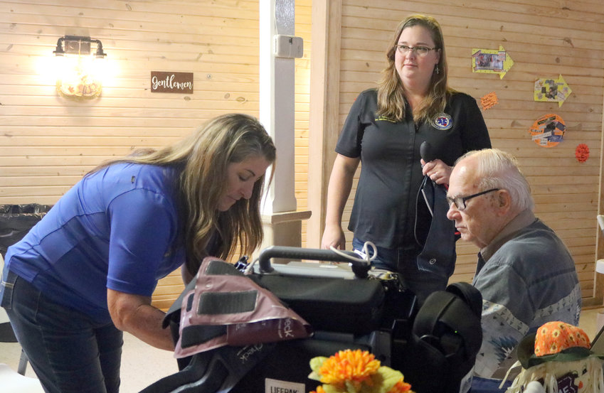 Ralph Sanders of Cat Spring gets his blood pressure checked by Tammy Wendel, left, and Candi Havemann of the Austin County EMS during the 9th annual Senior Citizens Health Fair, held Oct. 16 at the Liedertafel Hall. The event was sponsored by the Sealy Chamber of Commerce and 1st Texas Home Health.