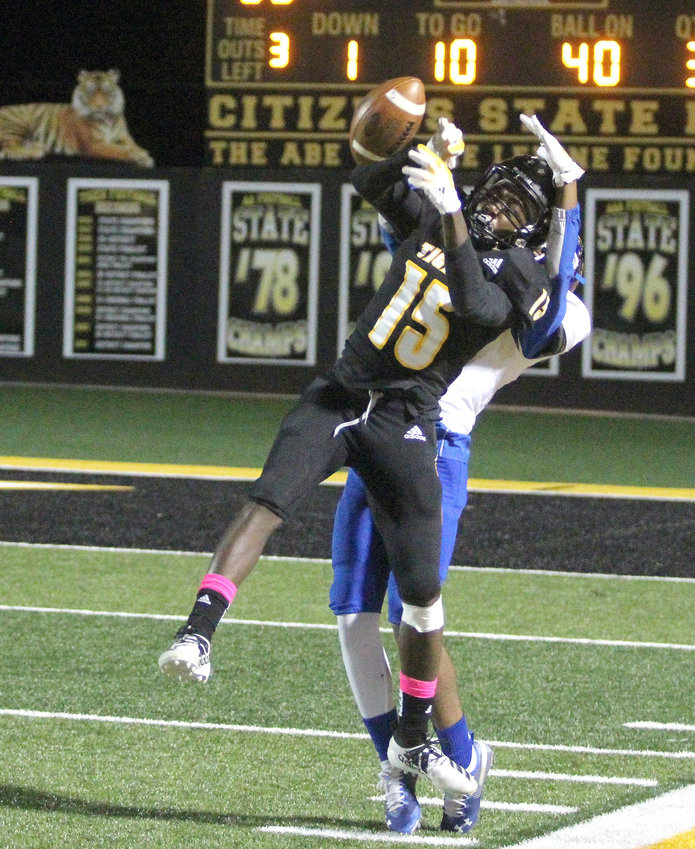 Draper Parker leaps for a catch but it's broken up by Bay City defensive back Amiron Holman in the second half of a district game that Sealy won 35-9 last Friday at T.J. Mills Stadium. This week, Parker and the offense will travel to West Columbia to face the stout defense of the Roughnecks.