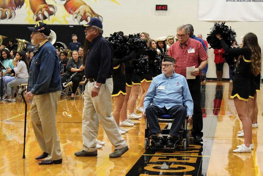 Locals veterans who served the country were welcomed into the Sealy High School gym with the band playing and plenty of cheers to kick off the fourth annual Veterans Day assembly Monday morning.