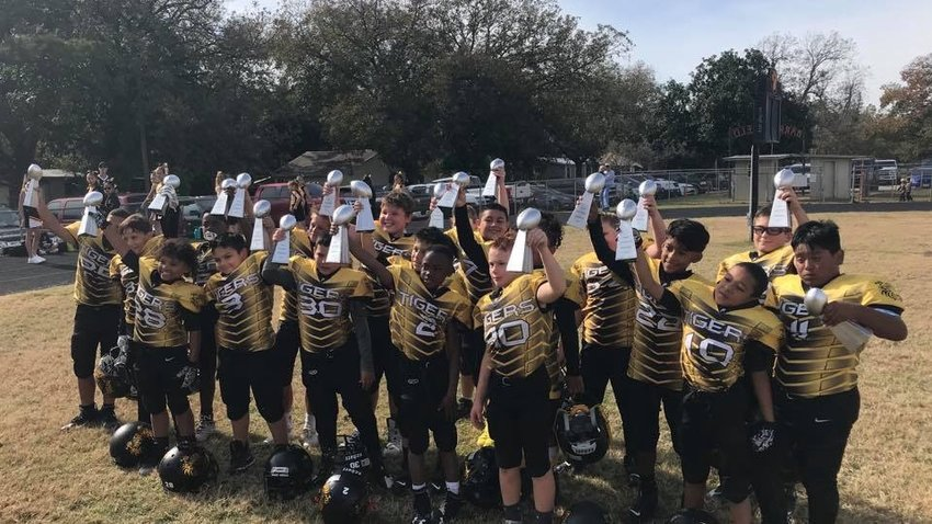 The junior varsity Tigers hoisted the Super Bowl trophy for winning the Colorado River Youth Football Coalition, capping off an undefeated season. It was this group's second straight trip to the championship game although they fell just short last year. This time around, they made sure to do things differently and won on a late field goal to be crowned champions.