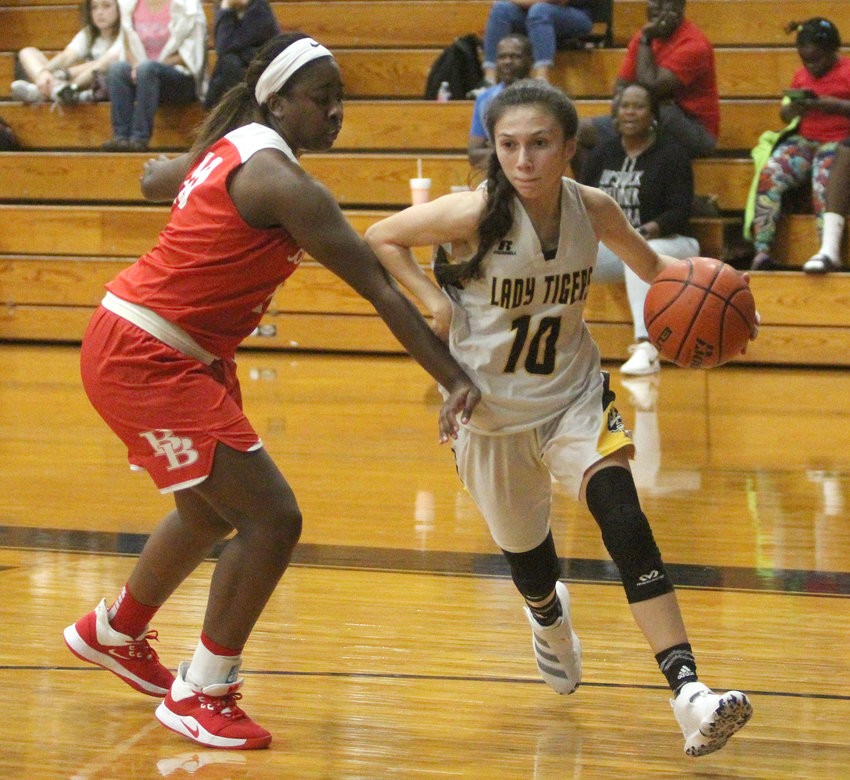 Heaven Hernandez drives to the bucket in a non-district matchup with the Bellville Brahmanettes last Tuesday afternoon at Sealy Junior High School, searching for one of her team second-best nine points. Hernandez added five steals, four rebounds and an assist in the rivalry win to move the Lady Tigers to 3-0 at home on the early season.