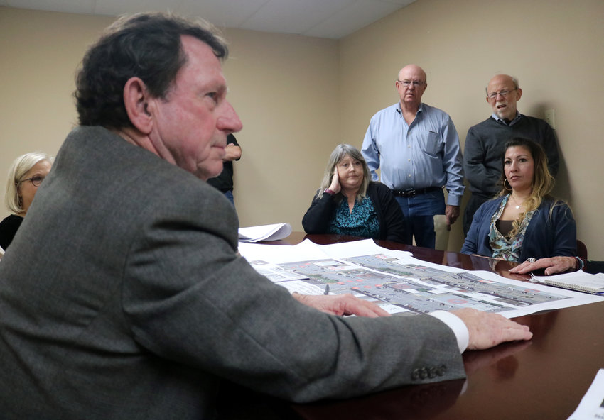 Sealy City Manager Lloyd Merrell talks about Main Street parking concerns with several downtown merchants at a meeting on Thursday at the Sealy EDC office. Pictured across from Merrell are, from the left, Susan Allen, David Krampitz, Sidney Levine, and Dorri Munoz.