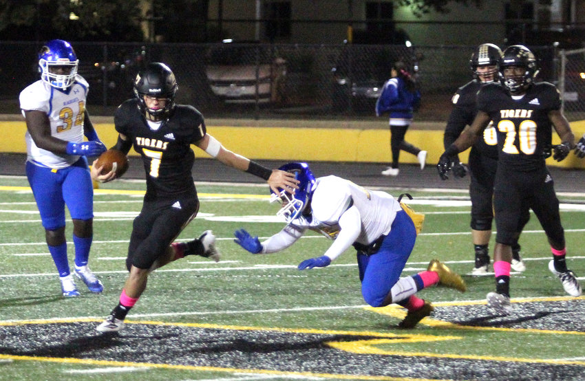Senior Reece Novicke ended his Sealy Tiger football career with all-district honorable mentions for his play at wide receiver, safety and quarterback; academic all-district honors; and academic all-state distinction. Pictured is Novicke escaping the pocket in a 35-9 win over the Bay City Blackcats at T.J. Mills Stadium in Sealy.