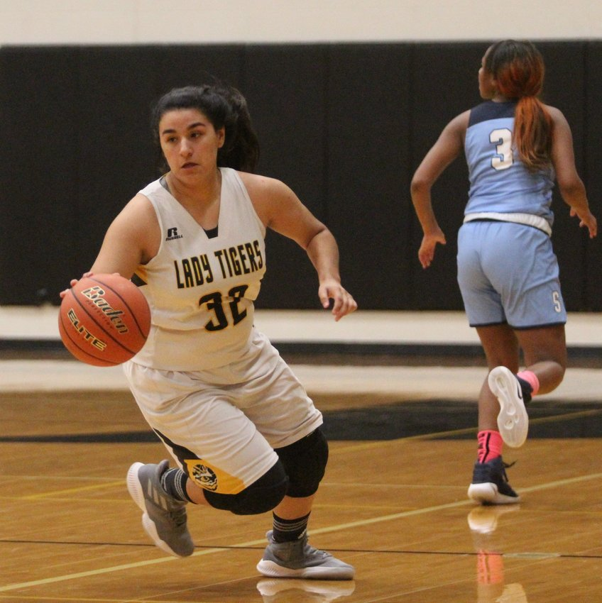 Kayla Camacho looks to start the fast break after coming up with a steal in non-district action against the Sweeny Bulldogs last week at Sealy High School. The Lady Tigers dropped the contest, 51-35.