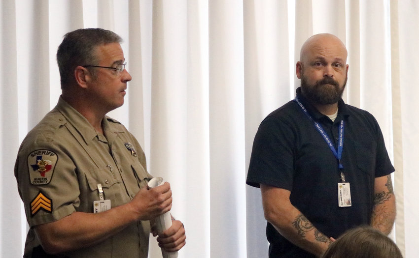 Austin County Sheriff's Deputy Donald Darracq, left, introduces David Watson to the members of the Austin County Commissioners Court at their Dec. 9 meeting. Watson joined the sheriff's office as an administrative assistant.