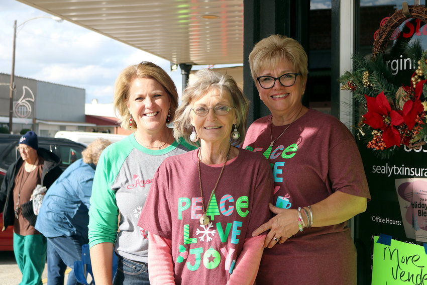 Karla Kitterman, Carla Sayle, and Becky Mills worked to make this year's Vendor Blender downtown a success. The annual event was held Dec. 5.