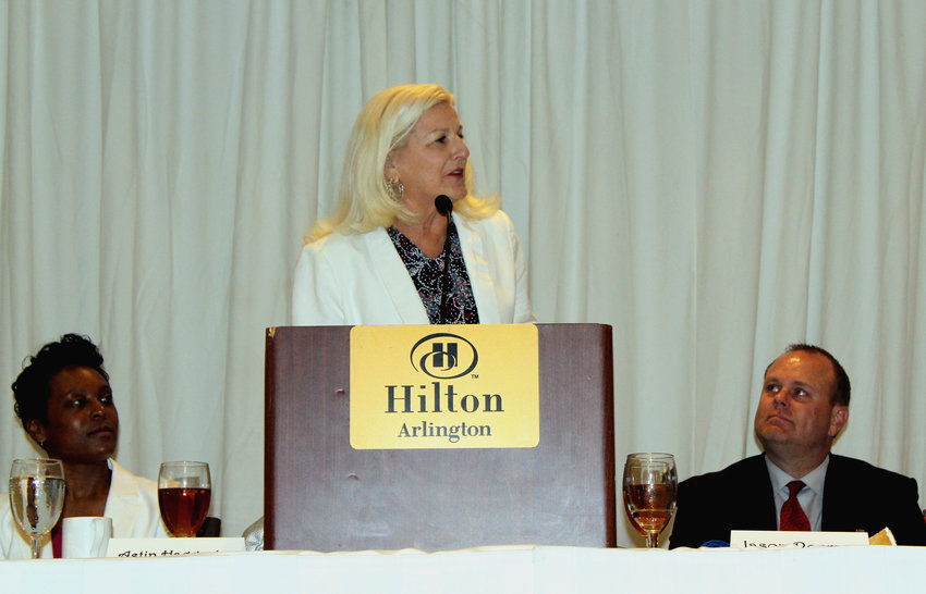 Bellville volleyball head coach Susan Brewer addresses the audience at the Arlington Hilton Hotel during her hall of fame acceptance speech at the Texas Girls Coaches Association's Honors Award Banquet, July 8.