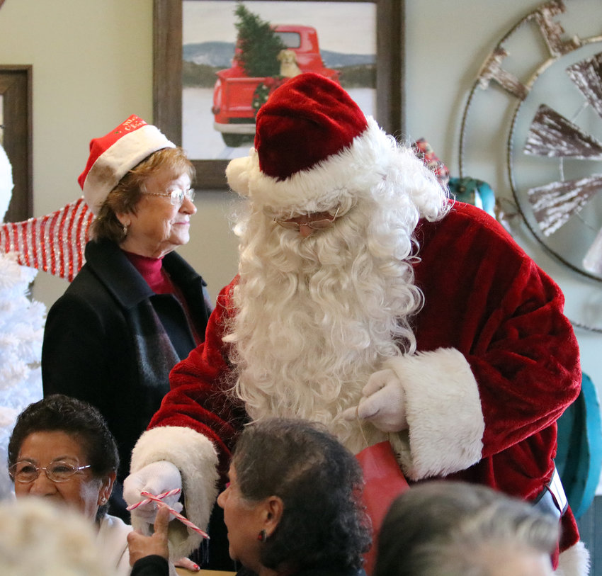 Santa made an appearance and handed out candy canes to residents of The Oaks and Silver Lake retirement communities Dec. 17 at their annual Christmas party at Tony's Family Restaurant.