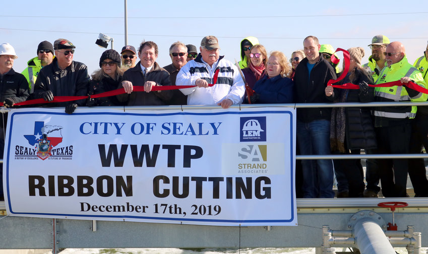 Members of the Sealy City Council and city staff gather to cut the ribbon on the city's new wastewater treatment plant Dec. 17. Mayor Pro Tem Sandra Vrablec cut the ribbon surrounded by city officials and staff to officially dedicate the $15 million, 2 million gallon-per-day facility. The city broke ground on the facility in 2017 but has been designing it since 2014. It replaces the 34-year-old 1 million gallon-per-day plant.