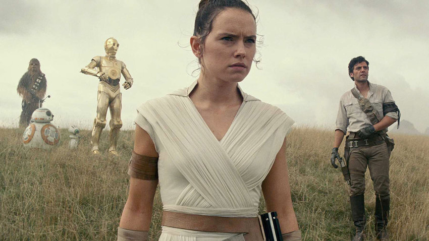 """Many questions are answered about Rey (Daisy Ridley), center, and the other Star Wars heroes (from the left) Chewbacca (Joonas Suotamo), BB-8, D-0, C-3PO (Anthony Daniels), and Poe Dameron (Oscar Issac) in """"Star Wars: The Rise of Skywalker"""" now playing in theaters."""