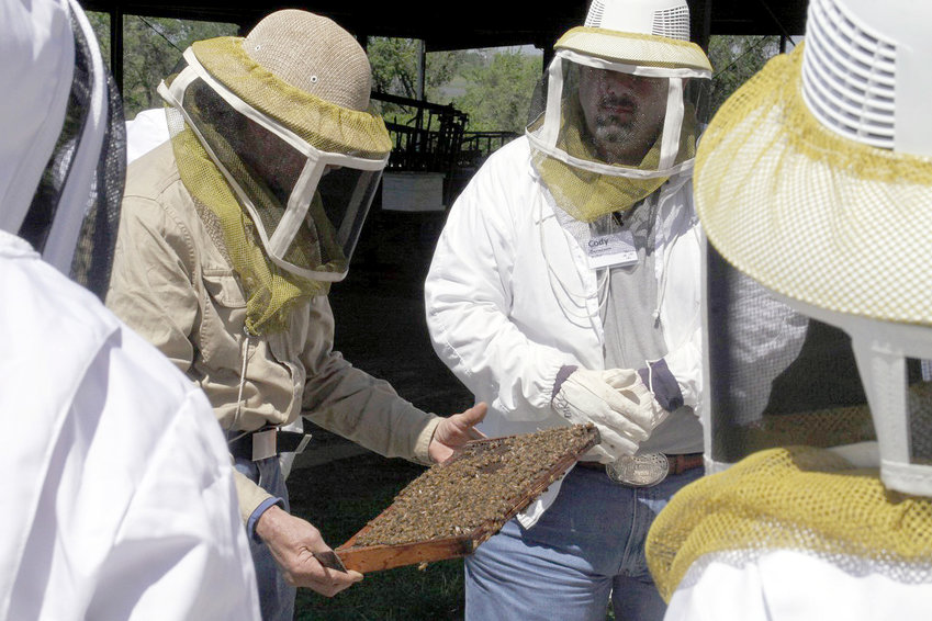 Students at the Bee School can suit up and watch while a hive of live bees is opened and inspected. The school will be held March 21 in Brenham.