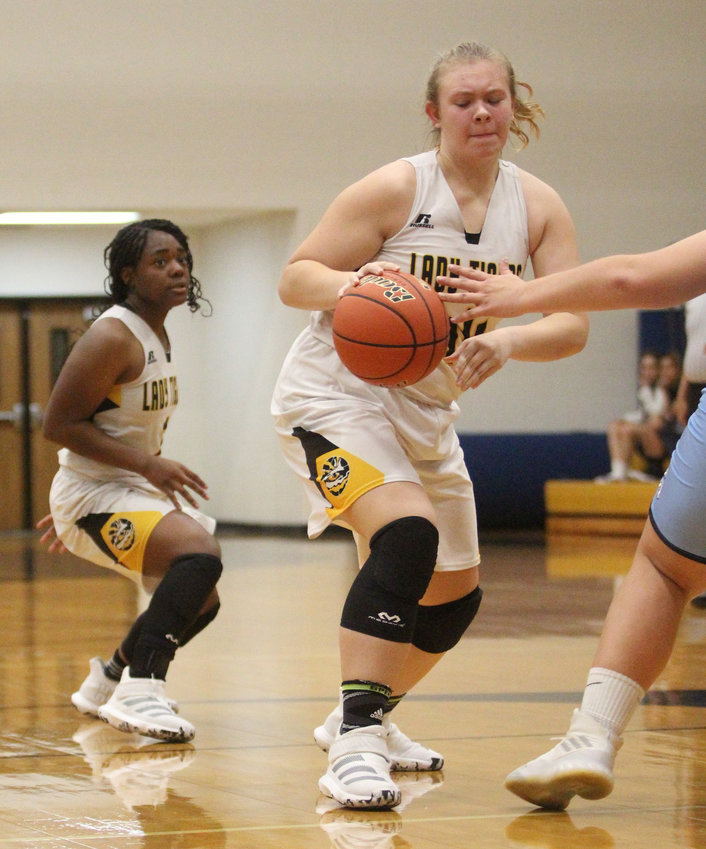 Julia Jurecka will look to provide a solid post presence for the Lady Tigers in their district slate that got underway Dec. 20 and will hit full stride Jan. 7. Pictured his Jurecka driving to the lane in a non-district contest with the Sweeny Bulldogs on Dec. 3.
