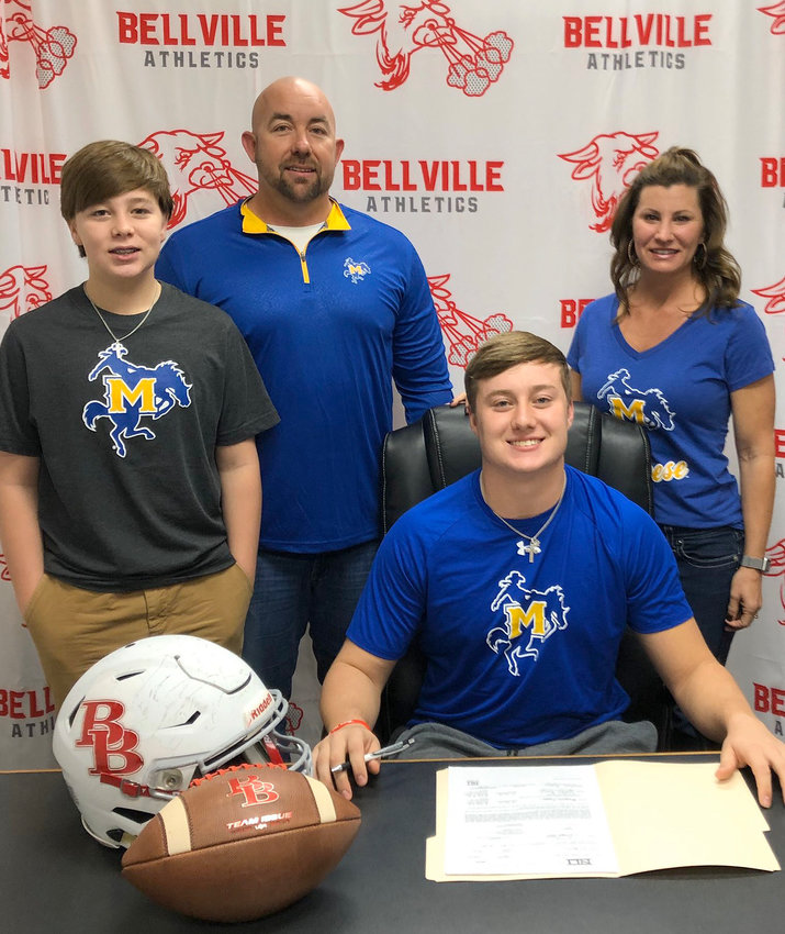 Bellville Brahma defensive end Grayson Mays was joined by his family in signing his National Letter of Intent to become a McNeese State Cowboy next year after two district defensive MVP awards and all-state recognition.