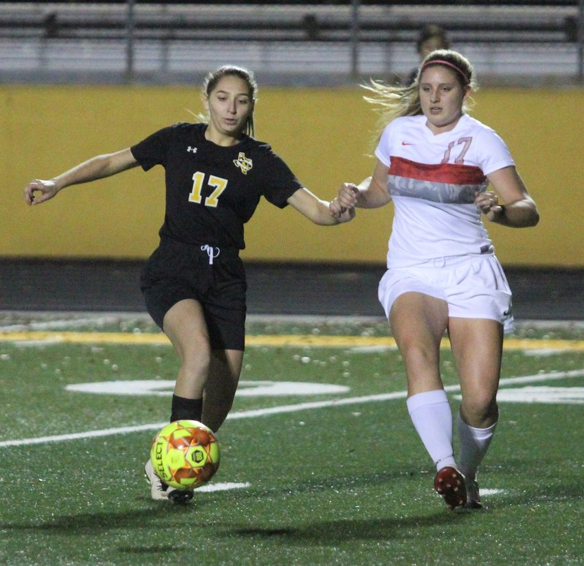 Sealy's Dania Picasso (17) battles Bellville's Karlie Babylon (17) in a non-district, rivalry matchup on the pitch last Tuesday night at T.J. Mills Stadium in Sealy. The Brahmanettes collected their second win over the Lady Tigers in a week's time, 10-0.