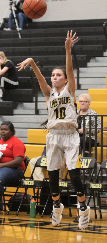 Heaven Hernandez added three points to the Lady Tigers' efforts against second place El Campo last Friday night, converting her 15th three-point shot of the season.