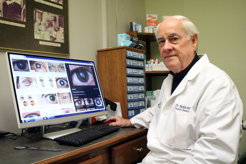 Dr. Paul Beckwith of Sealy Eye Center looks at different eye diseases depicted on his computer. He recommends people get their eyes examined to maintain good eye health in 2020.