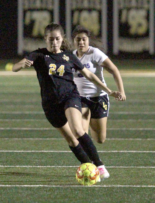 Destinee Castillo has been one of the key components of the Lady Tigers' offense so far and will look to increase her contributions when the district soccer season starts next week. Pictured is Castillo handling the ball ahead of a La Grange defender in last Friday night's non-district contest at T.J. Mills Stadium.