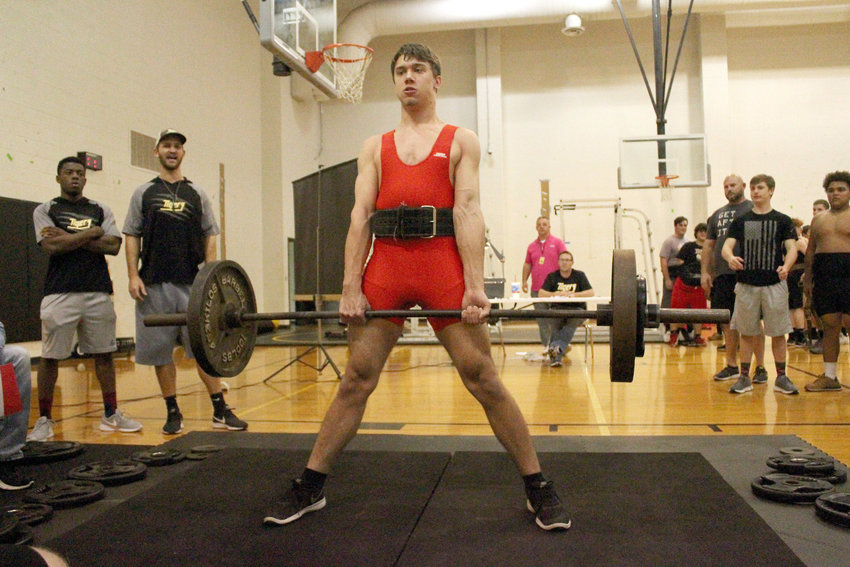 Matthew Mlcak turned out an impressive performance at the Edna Invitational last weekend, totaling 715 pounds in the second meet of the season. Pictured is Mlcak deadlifting at Sealy High School's host meet last year in the auxiliary gym.