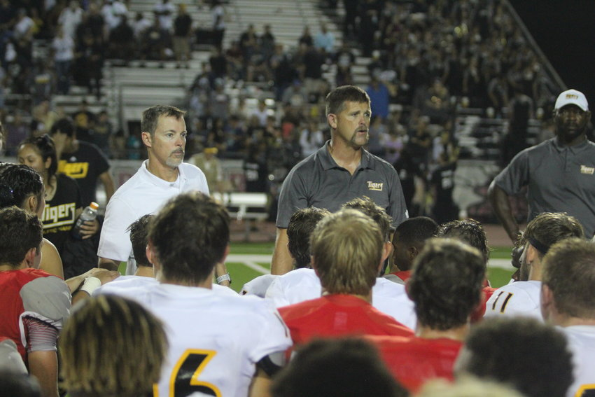 Head coaches Grady Rowe (Bellville, left) and Shane Mobley (Sealy, right) addressed both teams after this year's non-district matchup at the Pasture of Pain in Bellville which Sealy won, 34-14. After Monday morning's realignment, the county rivals will now compete in the same district in Class 4A's Division 2.