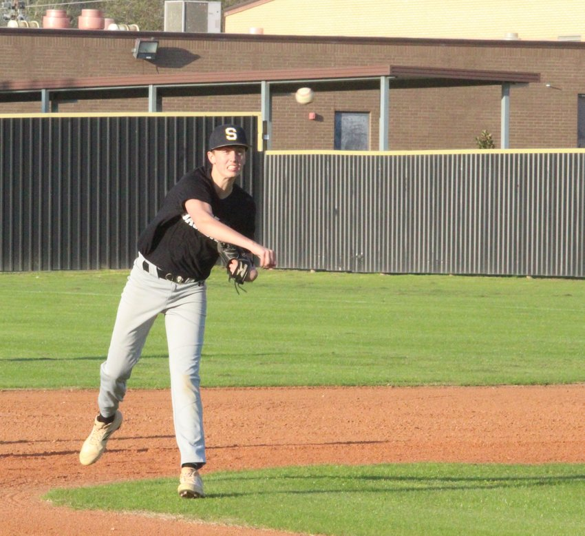 """Baseball players once again took the field at Aubrey """"Mutt"""" Stuessel Stadium in Sealy last Friday for the first tryout of the 2020 season. All three Tiger teams will have their first scrimmage of the year on Friday, Feb. 14 in Sweeny. Pictured is Daniel Eschenburg relaying a throw to the third baseman."""