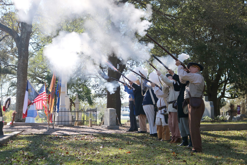 Members of the Texas Army and other ceremonial re-enactment groups fire a salute in honor of Mirabeau B. Lamar at his gravesite in Richmond's historic Morton Cemetery on Jan. 24. Lamar, the second president of the Republic of Texas, is honored each year as the Father of Texas Education in recognition of his setting aside three leagues of land in each county for public schools as well as the allotment 50 leagues of land for the support of two universities, later developed as Texas A&M University and the University of Texas.