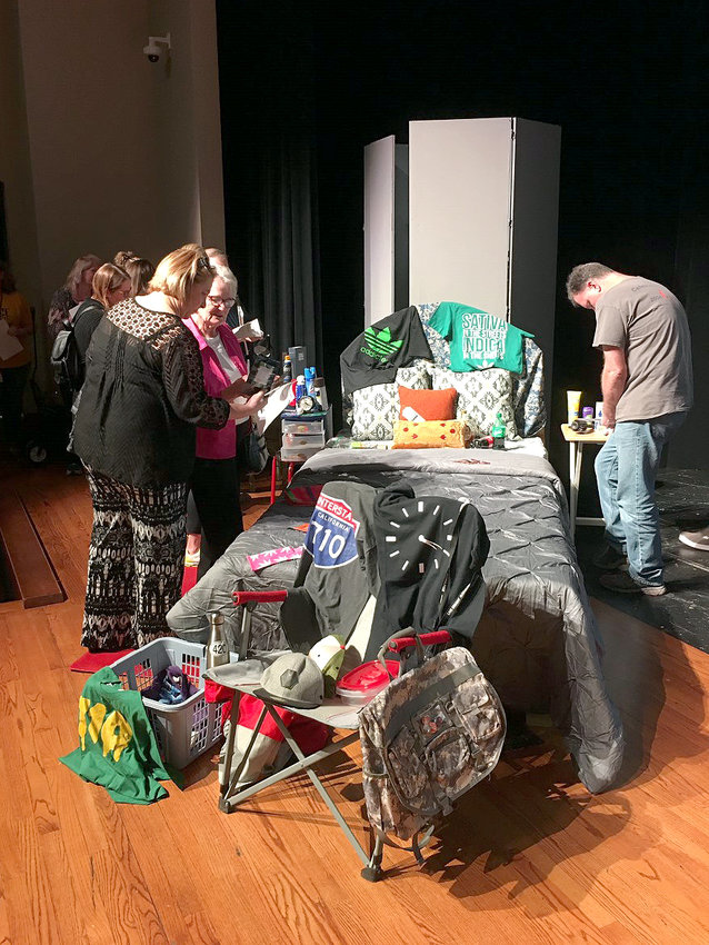Parents attempt to find contraband items in a typical bedroom as part of the Watch UR BAC program at Sealy High School.
