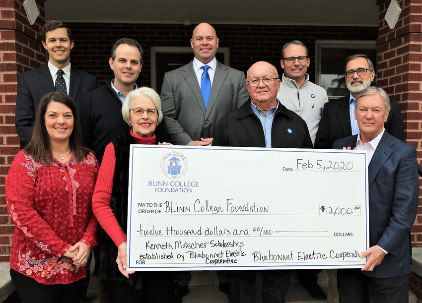 Bluebonnet Electric Cooperative has funded an endowed scholarship at Blinn College in honor of longtime board member Kenneth Mutscher. Pictured are (front, from left) Renee and Sarita Mutscher and BEC board members Byron Balke and Ben Flencher, and (back, from left) Blinn Foundation Board Chair Samuel Sommer and Vice Chair Kevin Mutscher, BEC General Manager Matt Bentke, BEC Community Representative Kyle Merten, and BEC board member Robert Mikeska.