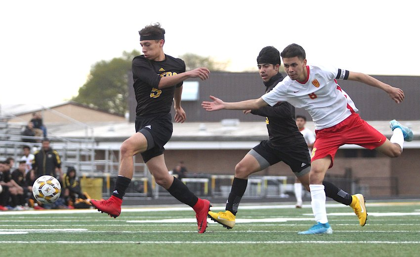 Angel Guerrero provided multiple key stops in the Tigers' defensive end of Monday's contest against the Stafford Spartans on Mark A. Chapman at T.J. Mills Stadium in Sealy. Pictured is one of the clears he made against Stafford's Raul Rodriguez in the first half of the Spartans' 3-0 win.