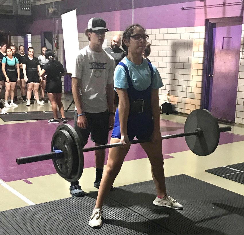 Ana De La Portilla supplied her best meet of the year, totaling 590 pounds to finish eighth in the 148-pound weight class at the Raider Booster Club Meet at Rice Consolidated last Saturday, nearing a 100-pound increase since the season-opening meet. Pictured his her locking out a 205-pound deadlift during the first meet of the season at Weimar High School.