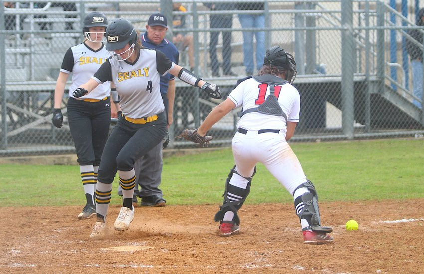 Avery Oliver scored the Lady Tigers' seventh run after a rundown in the second inning of Sealy's 20-4 district-opening win over the Royal Lady Falcons Monday morning in Brookshire. She finished with one hit, one RBI, and two runs scored.