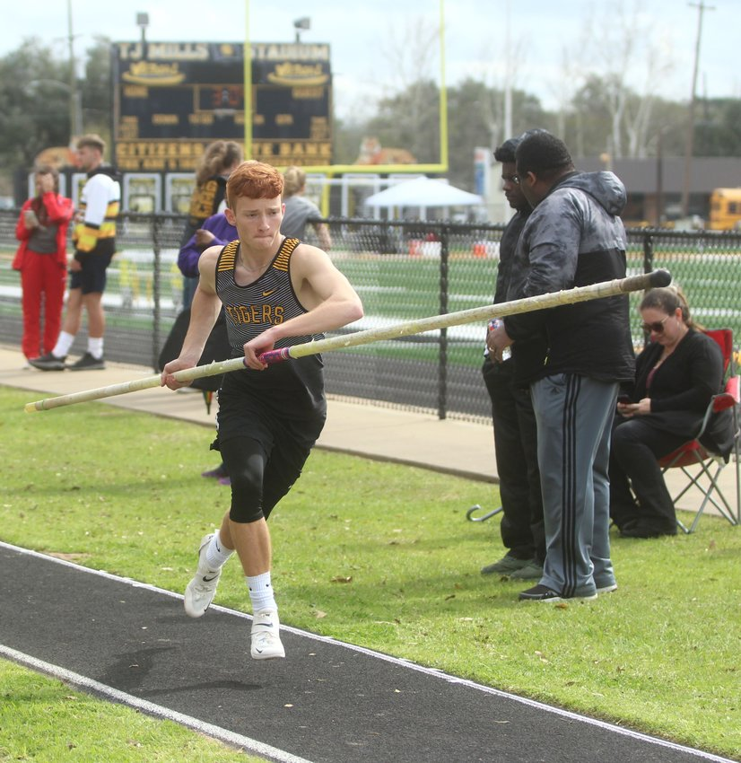 Joel Gassiott provided one of four first-place finishes for Sealy at Needville's Ketchum Relays on Feb. 28, registering a pole vault of 13 feet to win the event. Pictured is Gassiott on the runway at T.J. Mills Stadium during last year's Sammy Dierschke Relays in Sealy.