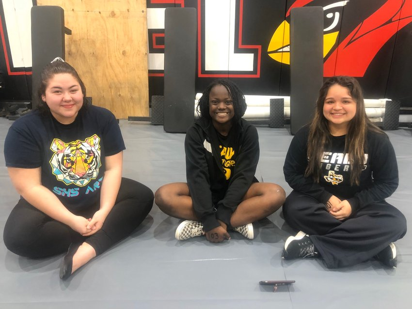 Three Sealy powerlifters qualified for the regional competition at Del Valle High School last Saturday, March 7. From the left, Sabrina Terrill took fourth from the 259+ weight class, Broccisha Williams bombed out, and Melanie Nieto took seventh from the 165-pound weight class.
