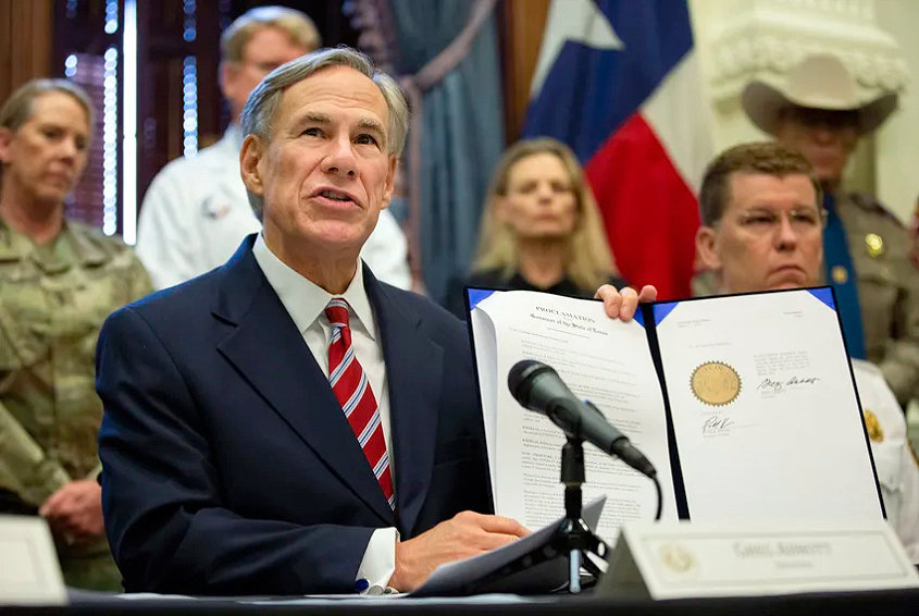 Gov. Greg Abbott signs a disaster declaration regarding the coronavirus pandemic. On Wednesday he signed a proclamation allowing cities to move their elections from May 2 to November.