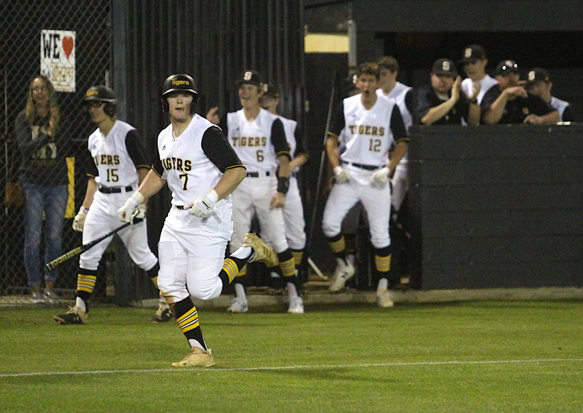 "Senior Garrett Redden, along with his classmates, are on the verge of losing their final season in Sealy Tiger black and gold after the coronavirus outbreak has forced UIL to extend its suspension on sanctioned activities until May 4. Pictured is Redden scoring a run in what could be the only home action for the Tigers, a 9-8 loss to Bellville at Aubrey ""Mutt"" Stuessel Stadium on March 2."