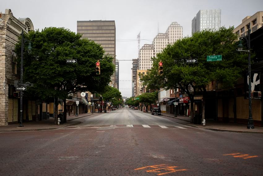 Sixth Street remains empty during morning rush hour in downtown Austin.
