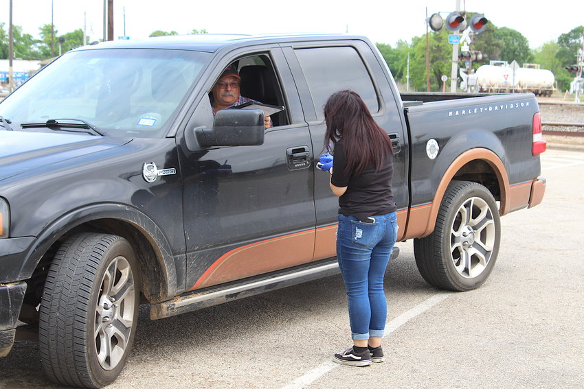 Taking orders has changed a little bit during the coronavirus pandemic as examples by Nathalia Avila and Jackie Hanson at Mesquite Mexican Grill in Sealy.