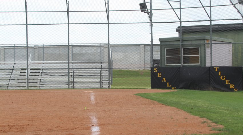 The bases will stay in the shed, stands will remain empty and backstops will go unused as the University Interscholastic League canceled the remaining athletic activities after Gov. Abbott announced no schools would return to physical session this year. Pictured is the softball diamond at Sealy High School where the Lady Tigers split their only two district games this year.