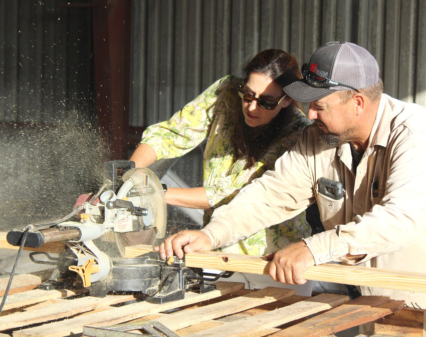 Sealy ISD Superintendent Sheryl Moore (left) got her hands dirty over her six years at the helm but said she's ready to ride off into the sunset and is comfortable with her decision to retire from education at the end of this school year. Pictured is Moore and Tim Hrachovy making a cut one August morning to help the 18+ special education program construct cornhole boards that were later auctioned off.