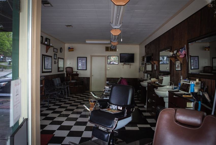 The San Marcos Barber Shop and other Texas salons can reopen Friday as long as hairstylists work with only one customer at a time and customers maintain a 6-foot distance from one another.