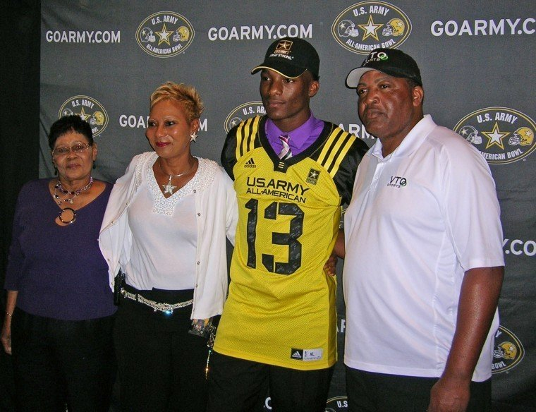 Sealy's Ricky Seals-Jones (13) was a five-star recruit after his career as a Tiger, which earned him a spot in the U.S. Army All-American game as a senior. Pictured is Seals-Jones with (from left) his grandmother Bobbie Seals, mother Buffy and father Chester during a ceremony on Monday, Nov. 19, 2012, at Sealy High School.
