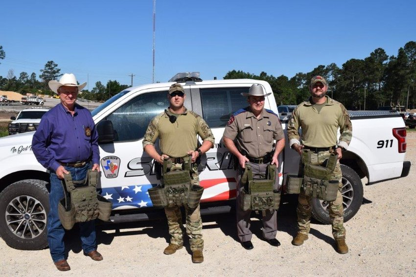 On April 23, 2020, the Austin County Sheriff's Office (ASCO) and the Austin County Special Response Team (SRT) received a donation of four tactical vests from the Texas Department of Public Safety (DPS). County Sheriff Jack Brandes said he and the SRT greatly appreciate the generous donation of the vests which will help provide safety and an extra level of protection in emergency situations. Pictured from the left are Austin County Sheriff Jack Brandes, SRT Sgt. Rob Lockett, DPS Lt. Darren Vacek and SRT Sgt. Matt Walls.