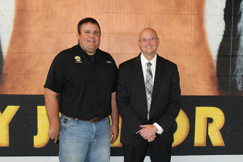 Bryan Hallmark (right) was officially hired as Sealy ISD's next superintendent at April 24's meeting of the board of trustees and his first day of work on May 4. He said the first week was akin to drinking from a firehose at times but he looks forward to continuing the success Sealy has had in building professional learning communities. Hallmark is pictured with Sealy ISD Board President Ryan Reichardt at the board meeting on April 24.
