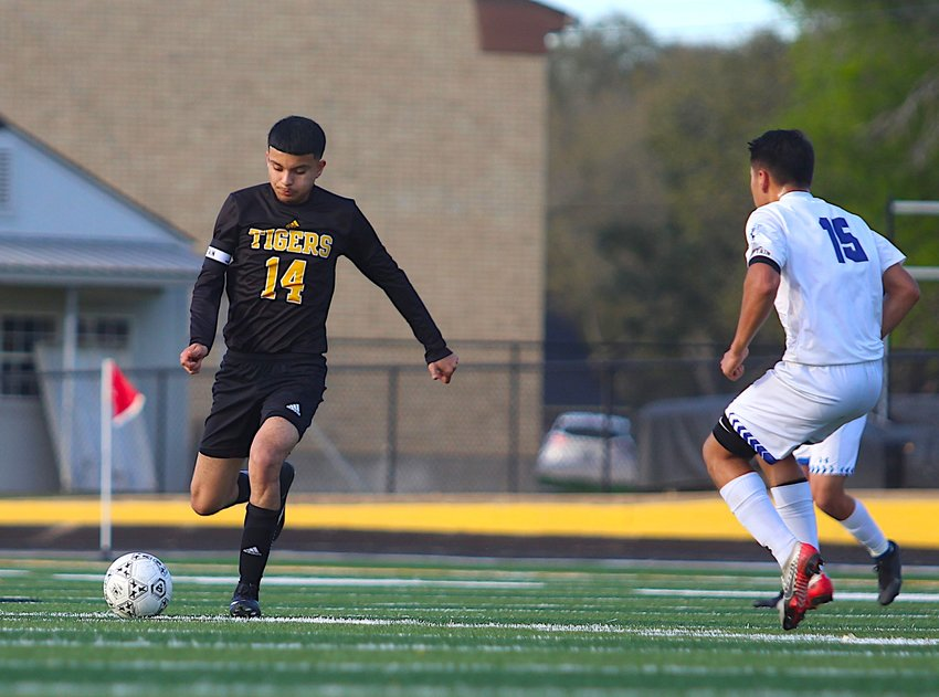 Sealy senior Jose Luis Arriaga garnered all-district first-team recognition in his final campaign for the Tigers even though the fourth-place team in District 23-4A did not get to finish the regular season. Pictured is Arriaga clearing a ball to the offensive end in a district matchup against Needville on Feb. 28 at T.J. Mills Stadium.