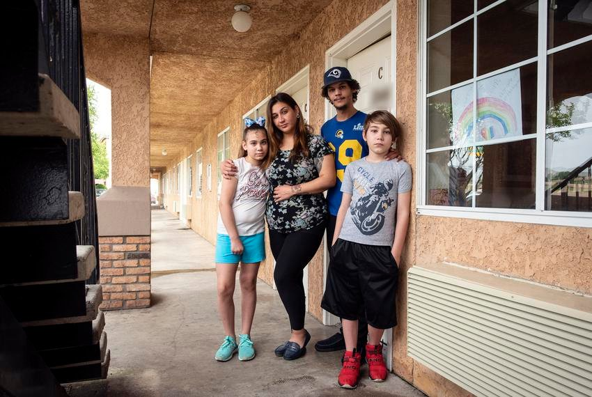 From left: Paetun Beavers, 11; her mother, Tie Hernandez; her stepdad, Andre Cameron; and her brother, Kingstun Beavers, 9, have been living at Budget Suites of America in Fort Worth for two months.