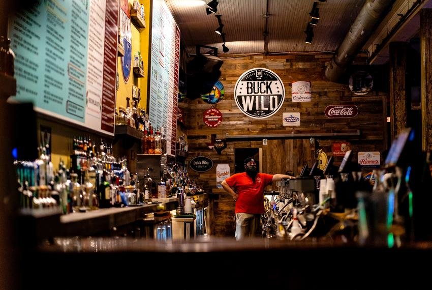 A bartender at Buck Wild in downtown Austin waited for customers last week.