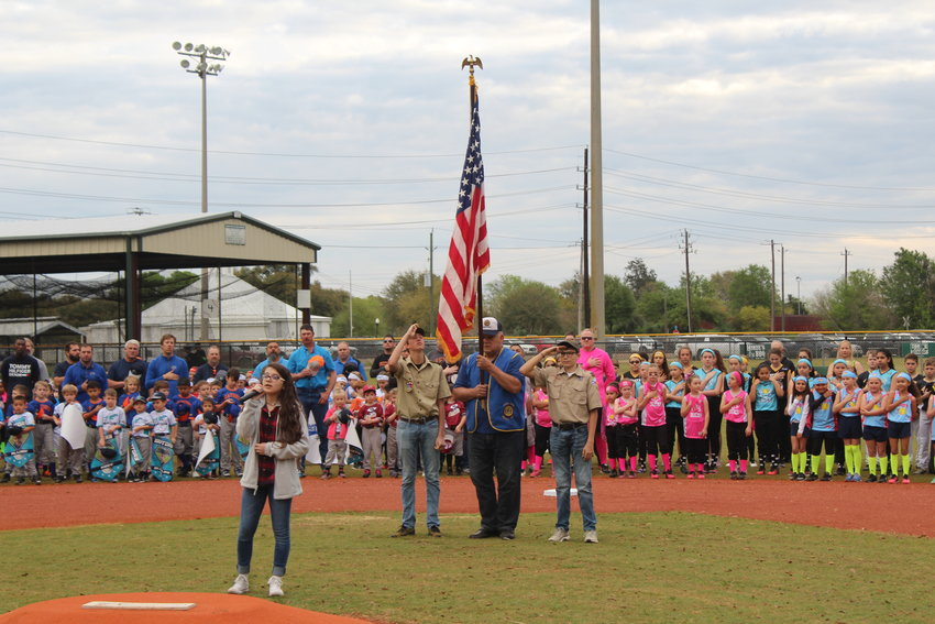 Greater Sealy Little League announced on May 18 that the 2020 season was canceled due to the new coronavirus pandemic. Pictured is the 2019 Opening Day ceremony where then-eighth grader Valerie Hahn sang the National Anthem while American Legion Post 442 Commander Paul Dronka and boy scouts displayed the colors.