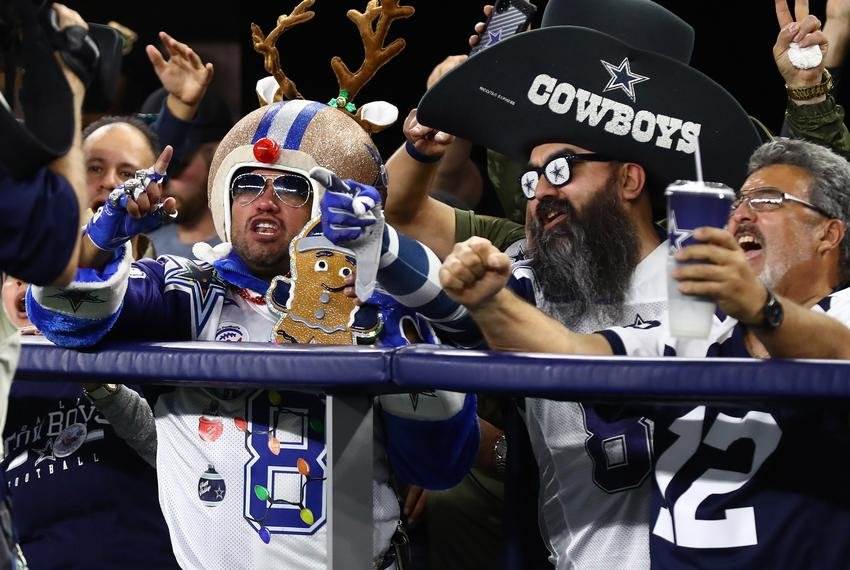 Dallas Cowboys fans cheer during the second half of a game against the Los Angeles Rams at AT&T Stadium.