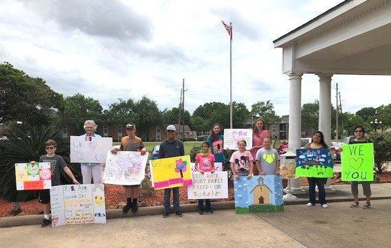 A group from Sealy's Immaculate Conception Church visited the Colonial Belle Nursing home in Sealy earlier in May to reiterate their support of those in the nursing home despite not being able to see them at in-person church services. Pictured from the left are Trevor Hrachovy, Bernice Novosad, Daegan Hrachovy, Nathaniel Ford, Naelynn Cano, Avery Eckelberg, Emersyn Eckelberg, Gloria Arriaga, Dottie Kutra. In the back row are Teaghan Eckelberg and Taylor Eckelberg.