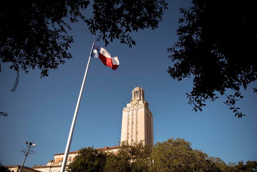 The Texas flag flies on the south lawn of the University of Texas at Austin campus.