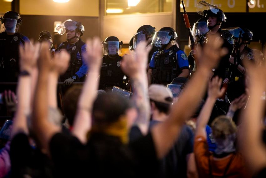 """Protesters demonstrating against police brutality last month raised their arms and chanted, """"Don't shoot!"""" after Austin officers fired tear gas and rubber bullets at the crowd."""